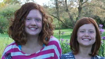 Two smiling girls with red hair